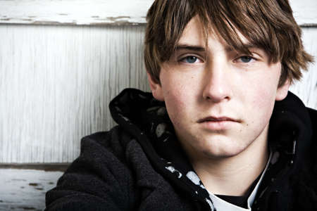 unconcerned: teen male portrait, expressionless closeup with copyspace Stock Photo