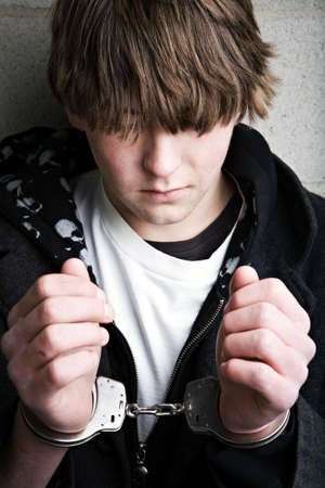 teen male portrait wearing handcuffs Stock Photo - 2548462