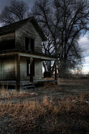 spooky house: haunted house (so I was told) in rural Wyoming, long abandoned. A dark, moody HDR image. Stock Photo