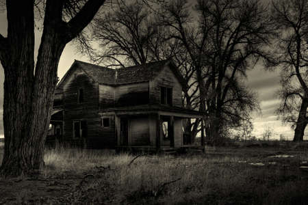 abandoned house: haunted house, as I was told by the locals. Shot in rural Wyoming. A dark, monochrome HDR image.