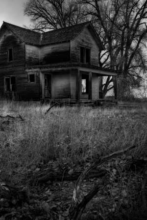 spooky house: haunted house, a dark and moody image converted to monochrome with added grain Stock Photo