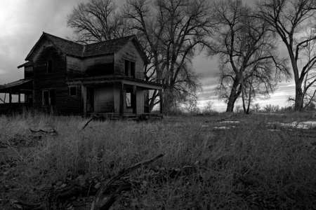 ghostly: haunted house in rural Wyoming, HDR image processed and converted to monochrome for dark, moody look Stock Photo