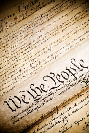 constitution: we the people - United States Constitution. Closeup, high contrast with light added grain.