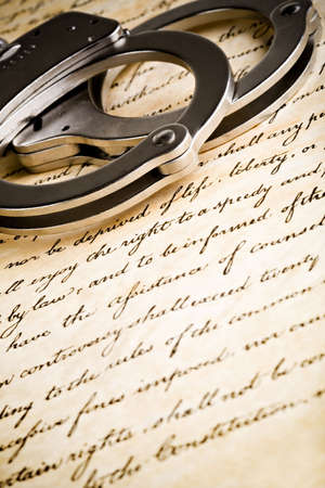 handcuffs on the US constitution Stock Photo - 2548812
