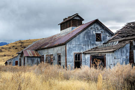 montana: abandoned buildings from an old coal mine in rural montana, HDR Stock Photo