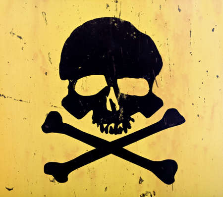 skull and crossbones from an aged sign photo