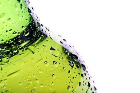 beer bottle abstract closeup, green wet bottle with water droplets, limited dof.  photo