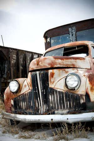 abandoned truck in rural wyoming junkyard photo