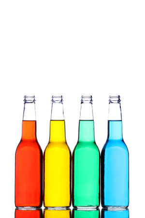 glass bottles with reflection and different colored liquids isolated on white