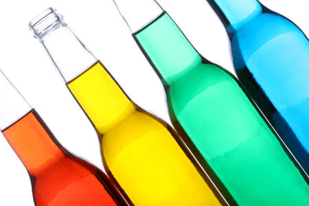 bottles with red, yellow, green, and blue liquids closeup isolated on white Stock Photo - 2548802