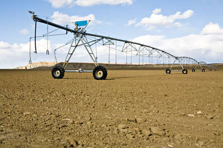 irrigation system - automated agricultural sprinkler system, ready and waiting for the season photo