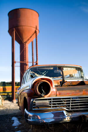 rusting: Vintage car broken and abandoned in a small town, Wyoming, United States