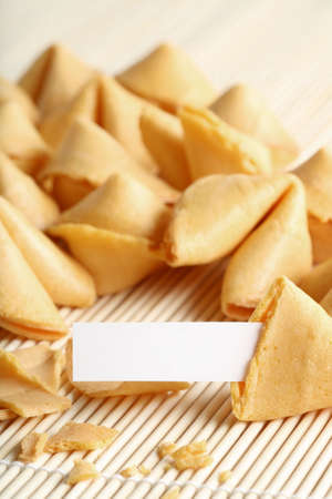 fortune cookie: fortune cookie open with paper and space for text, whole text area in focus