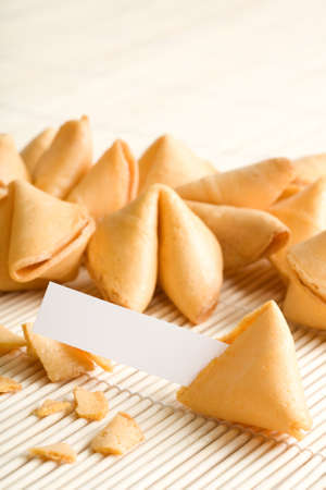 fortune cookies with blank paper for your own fortune, closeup with whole text area in focus