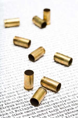 anti war: bullet shells closeup over the names of larger Iraqi cities, among others: Baghdad, Tikrit, Kirkuk, Balad, Fallujah
