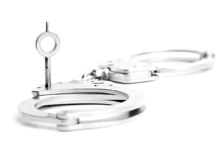 restraint device: handcuffs key macro isolated on white. focus on key ring. Stock Photo