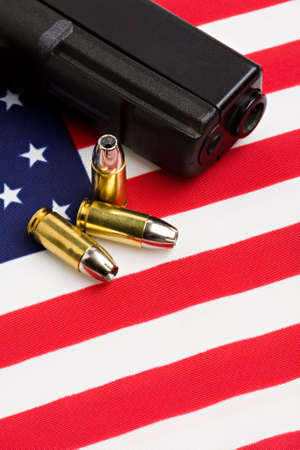 handgun and bullets closeup on American flag photo