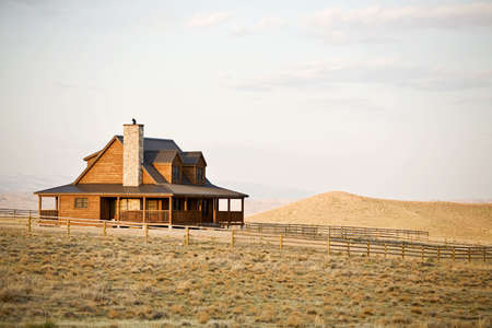 Ranch house newly constructed in late sun, rural midwest United States