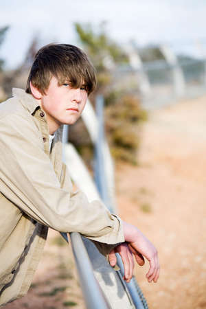 teen portrait outdoors leaning on a fence Stock Photo - 3020547