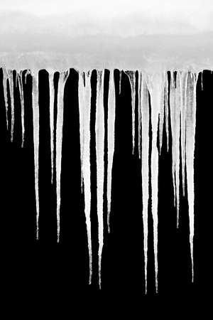 icicles shot isolated on solid black, design element