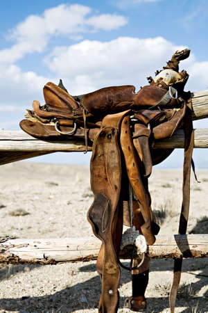saddle on a fence - a vintage saddle in rural Wyoming
