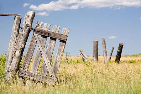 old broken fence door hangs crooked on a post Stock Photo - 3535051