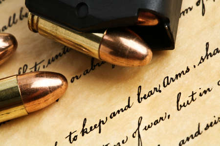 constitutional law: right to keep and bear arms - US Constitution Bill of Rights with 9mm bullets and magazine Stock Photo