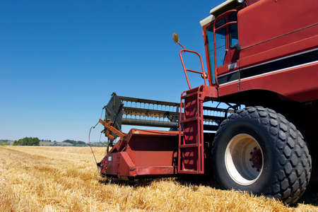 combine harvester side view close up on field photo