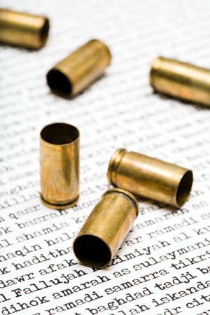 iraqi: bullet shells over names of various major Iraqi cities