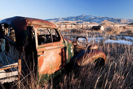 vintage car abandoned in a field, rural Wyoming photo