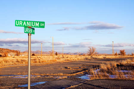 fled: Uranium Drive with road in disrepair. Jeffrey City, Wyoming - a Uranium-mining boomtown established around 1957. The city went bust when the mine shut down in 1982 and 95% of its population fled the city. Stock Photo