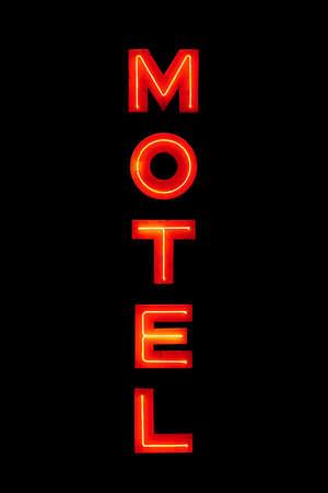 motel sign neon retro closeup isolated on solid black photo