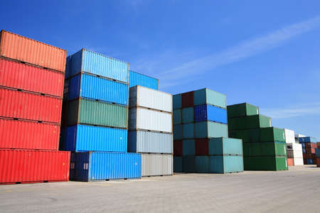 shipping containers - many cargo freight containers stacked in harbor photo