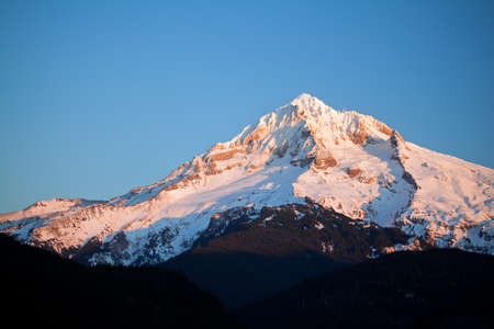 mount hood in the Winter - Oregon USA - late afternoon light. Highest peak in Oregon at 11,240 ft (3,426 m) Stock Photo