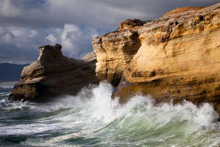 crashing: Oregon Coast landscape - beautiful rugged coastline with waves crashing against the cliffs. Stock Photo