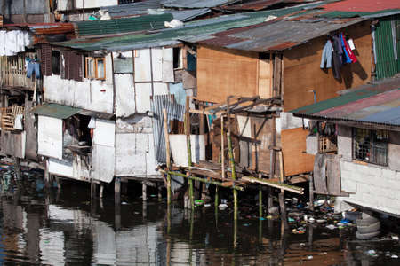 polluted river: Squatter homes in the Philippines - shacks in shanty town along heavily polluted Paranaque river in Manila.