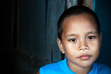 Portrait of an Asian child - Filipino boy by wall in natural light Stock Photo - 9102567