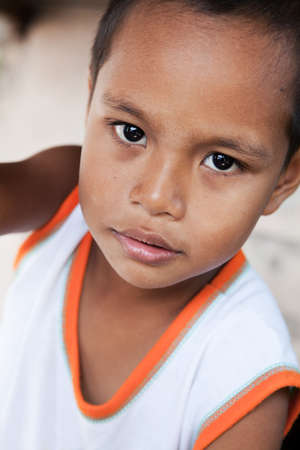 impoverished: Young Asian boy portrait - Filipino child from impoverished area in the Philippines Stock Photo