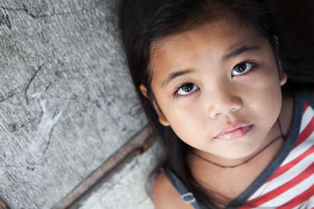 Young Asian girl portrait against grungy wall - Manila Philippines - natural light Stock Photo - 9102578
