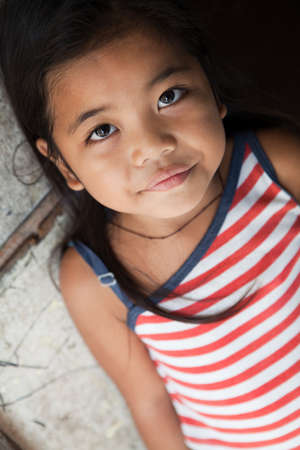 Asian girl portrait - Filipina against wall in natural light photo