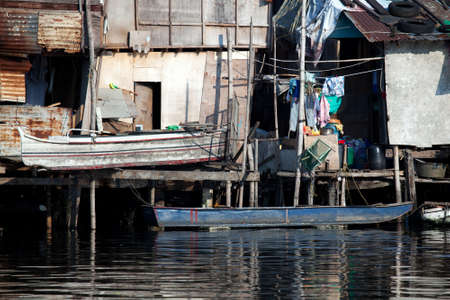 squatter: February 10, 2011: shanty squatter homes along the heavily polluted Paranaque River in Manila, Philippines. Editorial