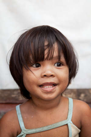impoverished: Portrait of an adorable Asian girl from impoverished area in the Philippines.