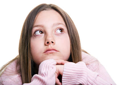 pre teen girls: pretty young girl hoping, wishing, or dreaming of something, closeup portrait isolated on white Stock Photo