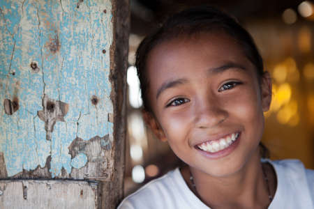 philippines: Portrait of a smiling Filipina girl from impoverished neighborhood in the Philippines.