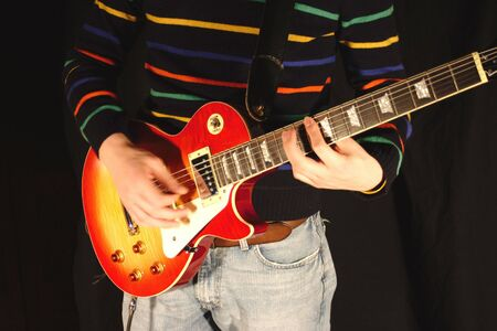 chord: Playing a Chord on a Classic Guitar While Standing