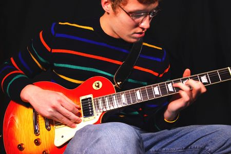 reverb: Young Man Playing a Classic  Electric Guitar