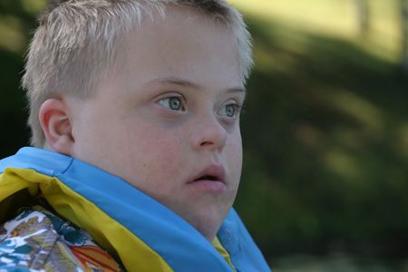 Down Syndrome Boy Wearing Life Jacket Stock Photo - 309259