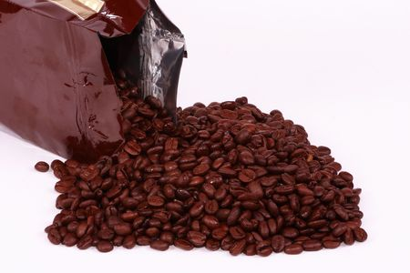 columbian: A freshly spilled bag of Columbian coffee beans. Stock Photo