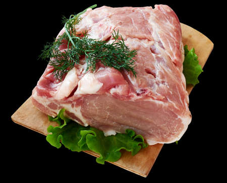 Raw meat on wooden cutting board isolated on black