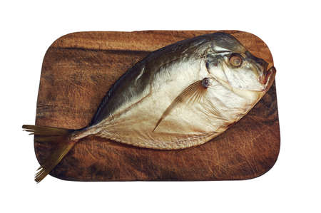 Smoked moonfish on cutting board isolated with clipping path